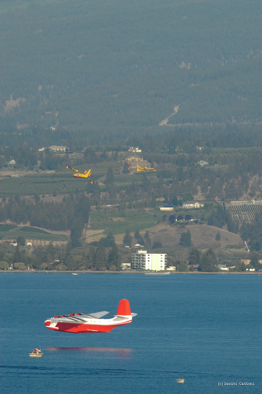 September 1st, 2003 - 18:14 PST Two CL-415s and a Martin Mars waterbomber were picking up water simultaneously. Some boaters came too close to the aircraft working on the water.